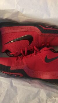pair of red Nike basketball shoes