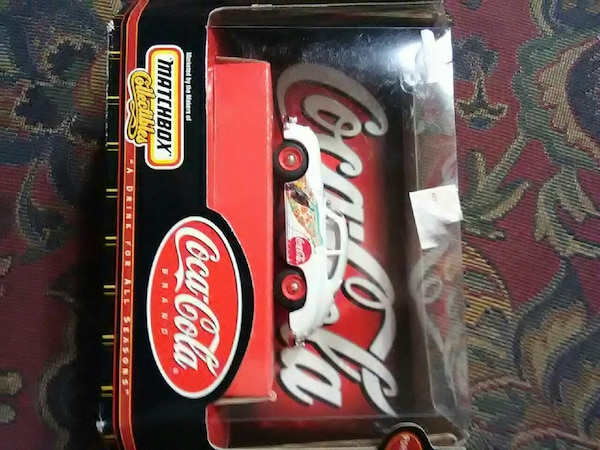white and red Coca-Cola stock car with box