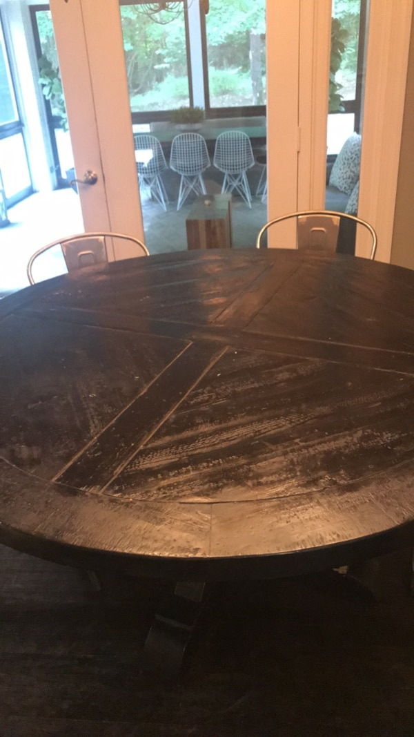 round brown wooden table with chairs