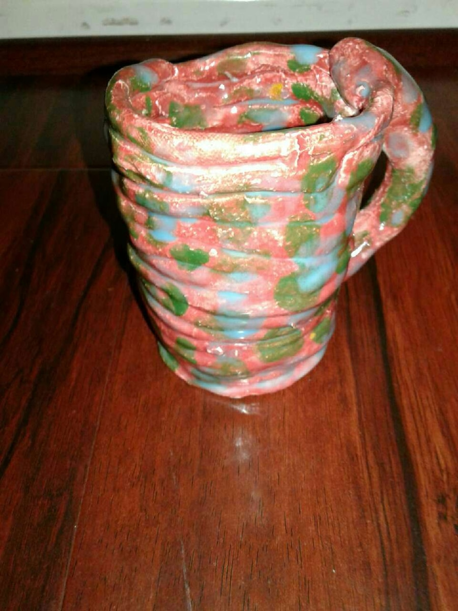 pink green and blue ceramic pitcher