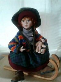 Porcelain doll w/wooden sled Hagerstown, 21740