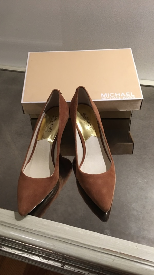 pair of brown Michael Kors leather pointed stilettos with box size 7