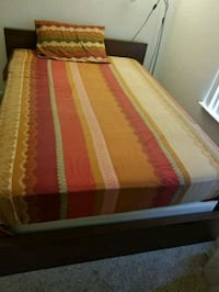 white, red, and yellow bed sheet Fremont, 94538