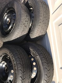 4 Steel Rims + All seasons tires used condition