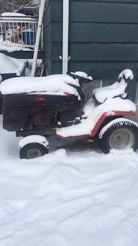 red and black riding lawn mower