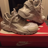 Pair of white nike air huarache with red box