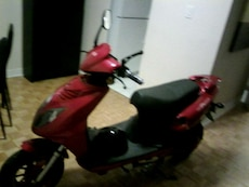 black and red electric scooter