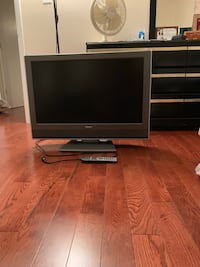 Gray flat screen television with black wooden tv stand Woodbridge, 22193