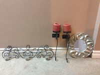 three black metal wall candle sconces