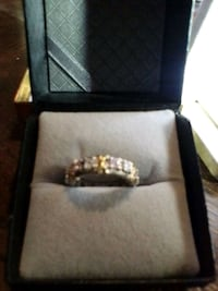 Ring with pink and diamond colored stones stamped 925
