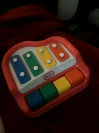 white, red, and green plastic toy Indio