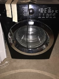 Black front-load clothes washer 529 mi