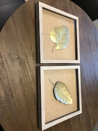Two silver leaf themed wall decors