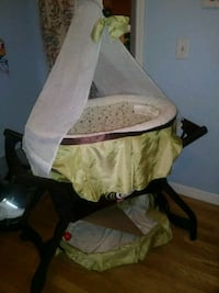 baby's white and green bassinet Woonsocket, 02895