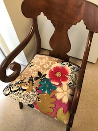 Brown wooden frame white and red floral padded armchair