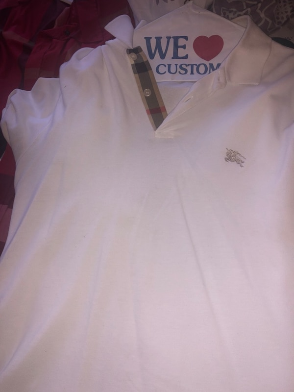 burberry polos size MED all buttons work no rips tears or nothing  17479930-8de9-4c2e-b6fc-97cd8ac43415