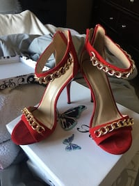 Red stiletto heels with gold chain size 7