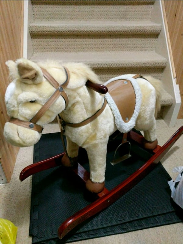 Rocking horse with battery powered moving parts 06241650-67d5-4caa-9328-444a9c7be5d2