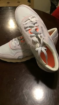 pair of white-and-red Nike sneakers 27 km