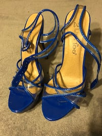 pair of women's blue leather open-toe pumps
