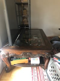 Antique glass top hand carved coffee table