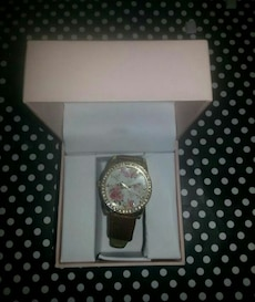 silver framed round floral analog watch