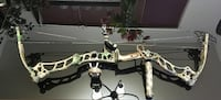 white and green camouflage compound bow
