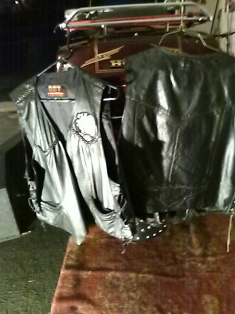 two black leather vests