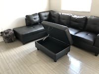 Black Faux Leather sectional with ottoman North Miami Beach, 33179
