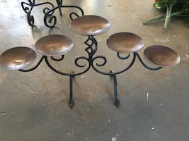 Black and brown metal candle holders