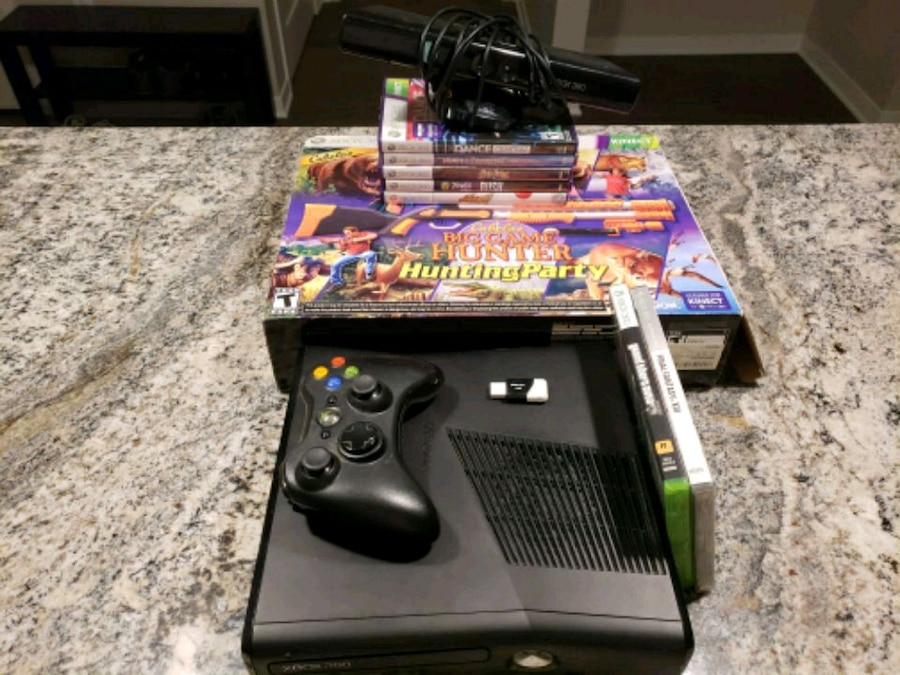 black Xbox 360 console with controller and game cases for sale  Shoreview