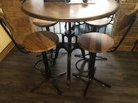 Cast iron custom made dining counter/bar table and chairs. Table can crank to adjust height. Stools can turn to adjust height  Mississauga, L5C 1A7