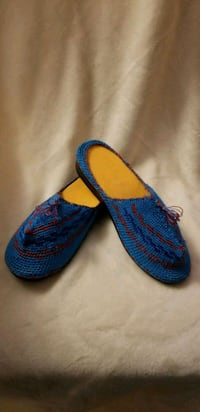 pair of blue-and-red knitted shoes 561 km