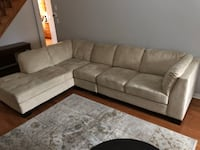 gray suede sectional sofa with throw pillows Toronto, M1R
