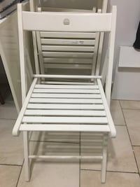 2 white wooden IKEA folding chairs Bowie