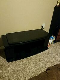 black wooden TV stand with flat screen television Colorado Springs, 80918