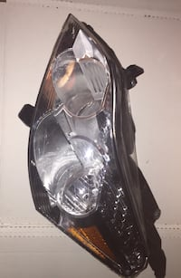 H LAMP ASM TRAVERSE LH;09-12