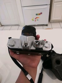 Konica vintage camera with original holder