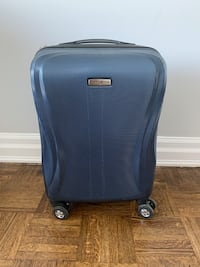 Small blue Samsonite suitcase
