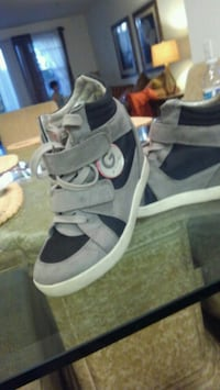 pair of gray-and-white Adidas sneakers