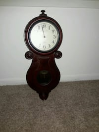 brown wooden framed pendulum clock McLean