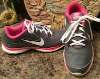 pair of gray, pink, and white Nike running shoes
