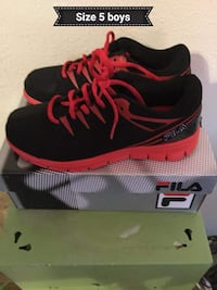 pair of black-and-red Nike running shoes Los Angeles, 90032