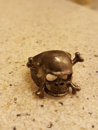 Men's sterling silver skull and crossbones ring  Lacombe, T4L 1T1