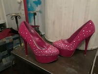 pair of red leather platform stiletto shoes 1024 mi