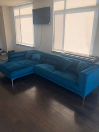Teal sectional couch.