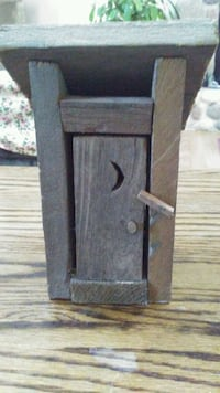 Decorative wooden outhouse