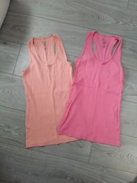 two pink and red tank tops Toronto, M5J 2X5