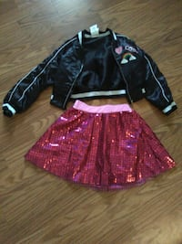 girl's black and white zip-up jacket and pink skirt