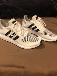 Never worn Pair of white-and-black adidas sneakers  Buena Park, 90620